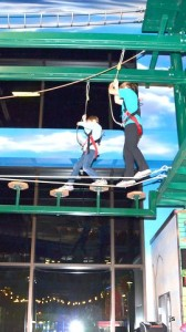 Photo of Adam and Hannah testing their courage on obstacle course at Wisconsin Dells.