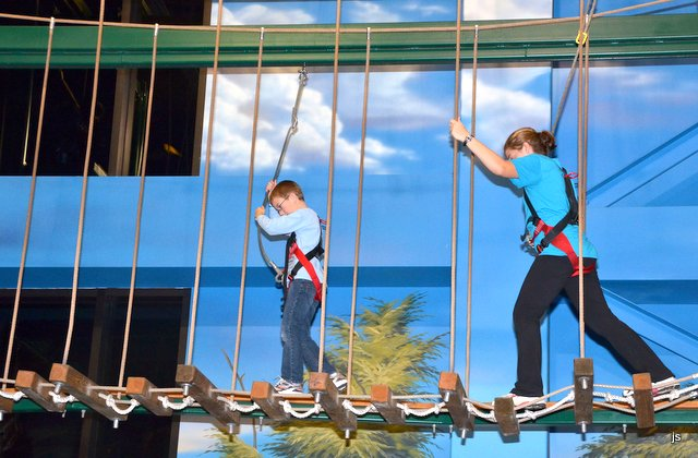 Photo of Adam and Hannah testing their courage on the rope course at Wisconsin Dells.