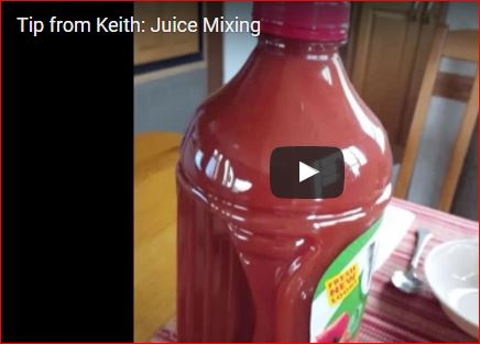 Still photo of juice mixing.