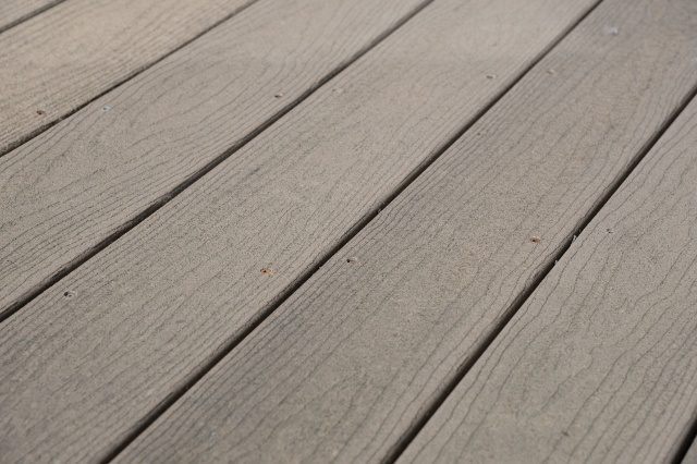 Photo of cracks in a deck.