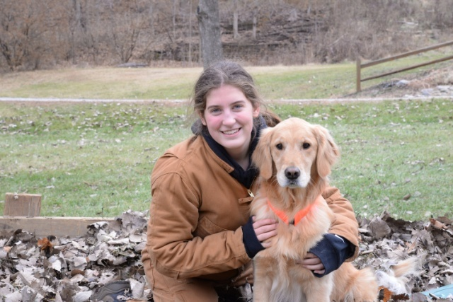 Image of Hannah and her dog, Sadie. Curiosity about a cat is this story!