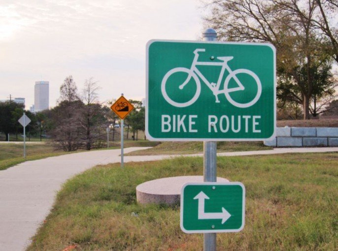 Photo of Bike Route sign, signifying simpler things.